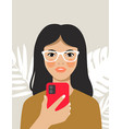 young girl holding smartphone in hands vector image