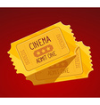 two yellow cinema tickets on red backgrou vector image
