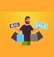 man holding purchases and big sale banners male vector image