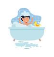 little cute kid is washing in bath