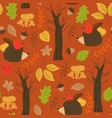 seamless autumn pattern with hedgehog vector image