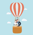 newlyweds in a hot air balloon vector image