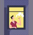 man smoking cigarette in window of brick building vector image vector image