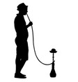 silhouette of a man smoking a hookah standing vector image