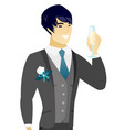 young asian groom holding glass of champagne vector image vector image