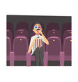young man in 3d glasses sitting in cinema theatre vector image vector image