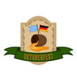 oktoberfest label with a beer barrel and flags vector image vector image