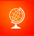 earth globe icon isolated on orange background vector image vector image