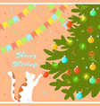 cat plays with a christmas tree and new year vector image vector image