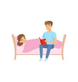 father reading bedtime story for his daughter who vector image vector image