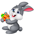 Cartoon bunny holding decorated egg vector image vector image
