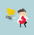 businessman attracting trophy with a large magnet vector image