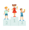 children standing on the winner podium with medals vector image vector image
