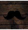 Moustache sign on wooden wall vector image