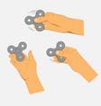 hands holding gray fidget spinner vector image vector image
