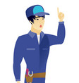 asian mechanic with open mouth pointing finger up vector image vector image