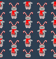 cat in christmas costume in snowball seamless vector image vector image