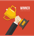 hand holding a golden winner cup vector image vector image