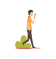 young man walking with smartphone in park guy vector image vector image