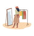 woman in fitting room trying on skirt at mirror