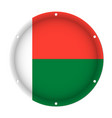 round metallic flag of madagascar with screw holes vector image vector image