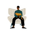 young african american man sitting in armchair vector image vector image