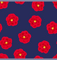 red camellia flower on navy blue background
