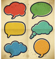 Vintage speech bubbles on the cardboard vector image