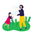 mother blowing soap bubbles with daughter outdoor vector image
