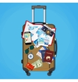 Tourist equipment on brown travel suitcase bag vector image vector image