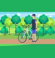 joyful athlete on track with bicycle vector image