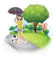 A lady holding an umbrella with a dog along the vector image vector image