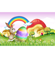 A bunny pushing an easter egg vector image vector image