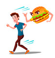 scared teen guy runing away from hamburger vector image