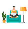 freelancer boy in armchair works at home vector image vector image