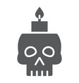 skull with candle glyph icon spooky and decor vector image vector image
