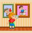 boy clean up the frame photo with the towel vector image vector image