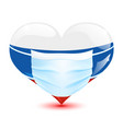 heart in flag colors with medical mask vector image