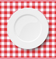 empty white plate placed on a kitchen table cloth vector image vector image