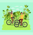 young couple on bicycle in the park vector image