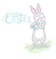 cartoon little bunny holding easter egg vector image vector image