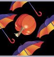 autumn open umbrella and and pumpkin on a black vector image
