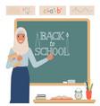 muslim teacher stands near school blackboard vector image