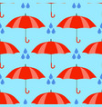 red umbrellas seamless pattern isolated on blue vector image vector image