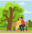 loving couple kissing on a wooden bench vector image