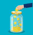 hand throws a gold coin in the jar vector image vector image