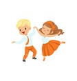 cute little boy and girl enjoying the dance vector image vector image