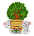 two elephant in front of an empty wooden signboard vector image vector image