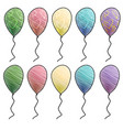 Colorful helium balloons with hearts