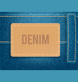 leather label on blue denim fabric vector image vector image